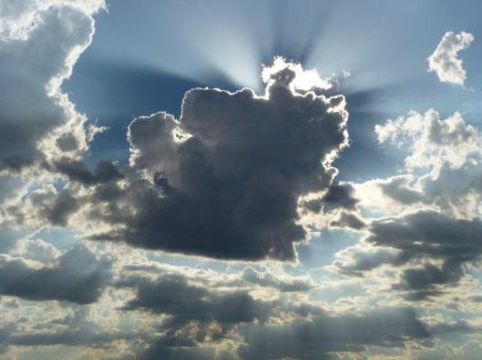 Setting-sun-behind-rain-cloud